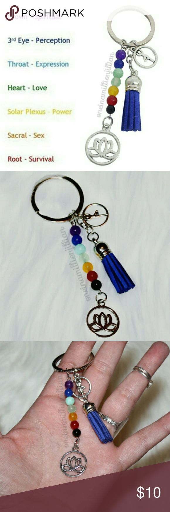 7 Chakras/Lotus Keychain New - Never Used  Features: ◇ 7 stone beads (1 for each chakra color) ◇ Lotus & Yoga charm ◇ Blue suede-like tassel ◇ Silvertone keyring  Chakra symbol meaning is all about connectivity. These emblems come from ancient Hindu tradition which is steeped in the knowledge that nothing is separate. Pull on one thread, it effects the entire fabric of life.  Check my page for more great items & discounts. #oneinamillionjillian Accessories Key & Card Holders
