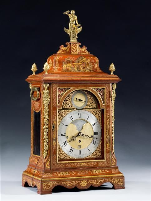 A GEORGE III RED LACQUER BRACKET CLOCK