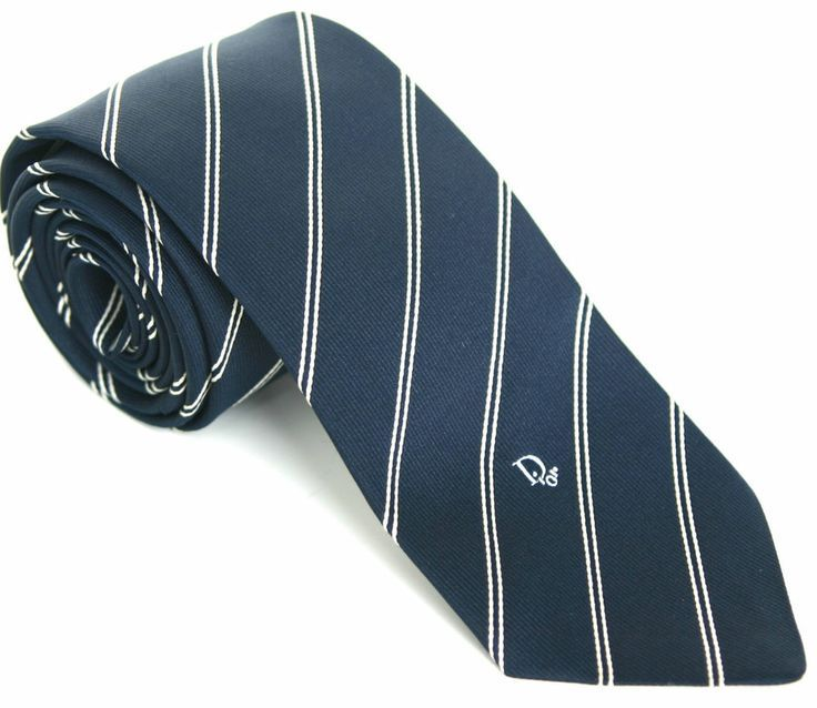 Dark Blue Off-White Woven Striped Skinny Vintage Necktie Tie (Dior). Its color and pattern works very well with the blue shirt & suit. Simple striped pattern tie looks formal, neat and serious.