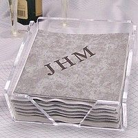 Clear acrylic cocktail napkin holder filled with personalized cocktail napkins
