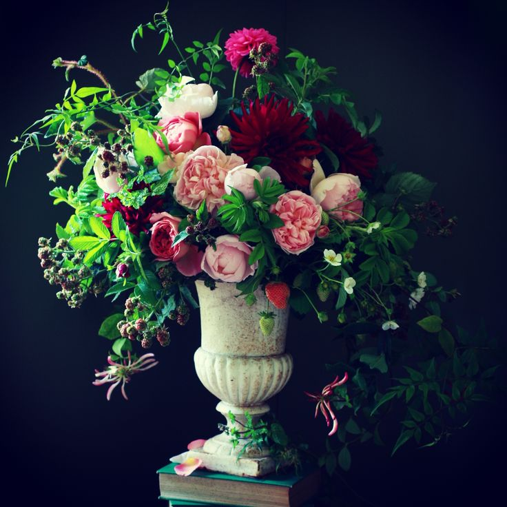 This is a very victorian flower arrangement. You see very similar arrangements in paintings from that era.
