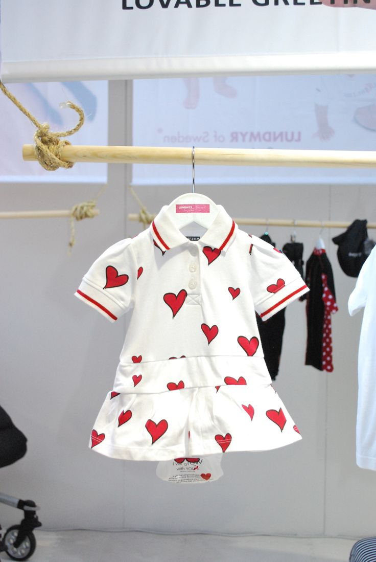 White pike dress with red hearts. Babygirl dress available in size 0-2 years.