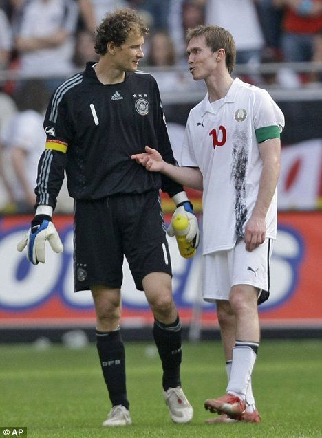 Jens Lehmann (Germany, 1998–2008, 61 caps, 0 goal) talks with Alexander Hleb (Belarus, 2001–..., 64 caps, 6 goals) during a friendly match between Belarus and Germany.