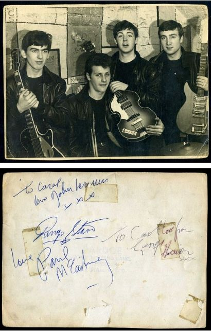 A signed photo of The Beatles with Ringo's signature on the back of the photograph that features original drummer Pete Best.