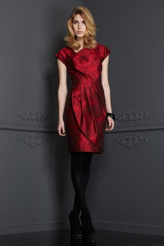 BRADLEY SCOTT ANGELICA This Swiss 100% Silk was woven into a floral Jacquard of roses. The richness of the color shading gives it a very true to life feeling. Asymmetric in design, flattering placement of the pleated wrap, this dress is perfect for a cocktail look or evening event. Fully Lined.  2 - 14