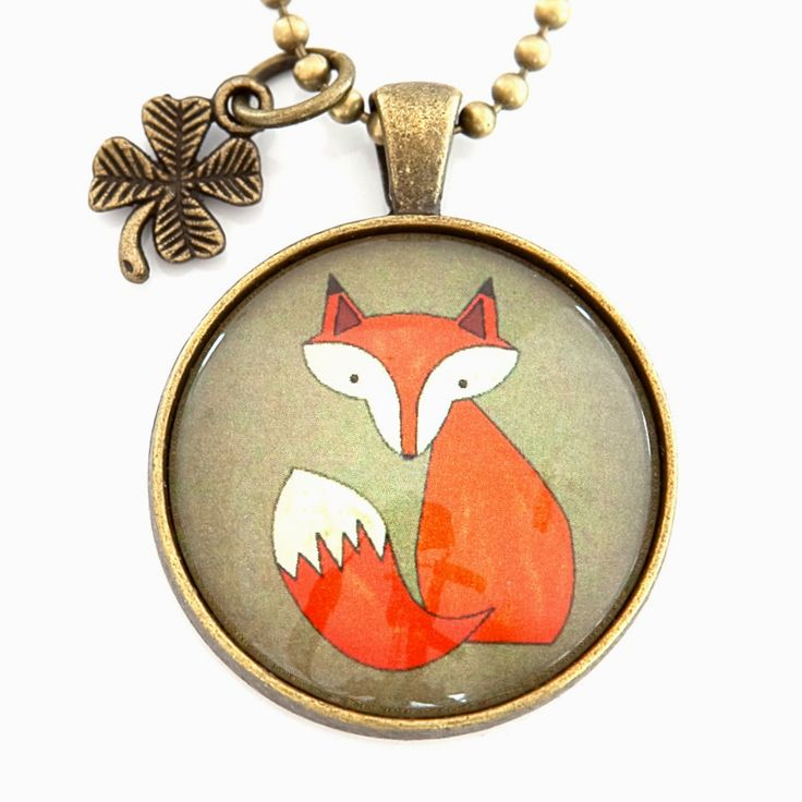 Fox pendant with clover charm.
