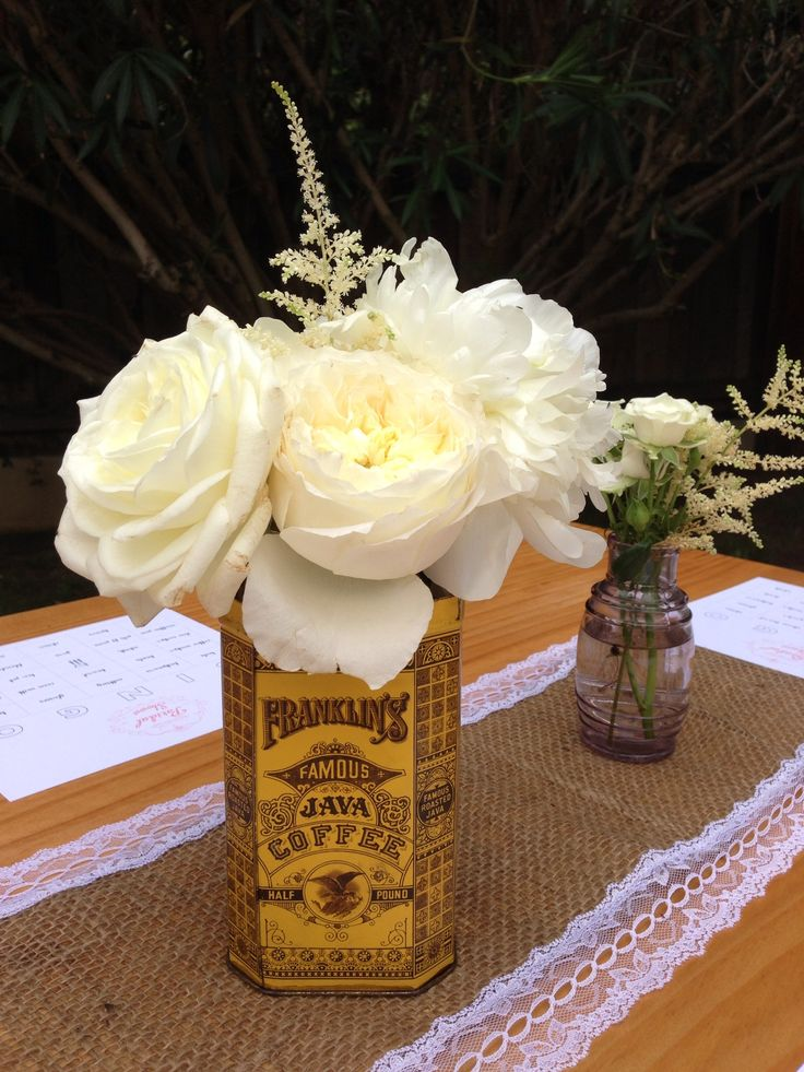 Vintage tin centerpieces with fresh flowers for this