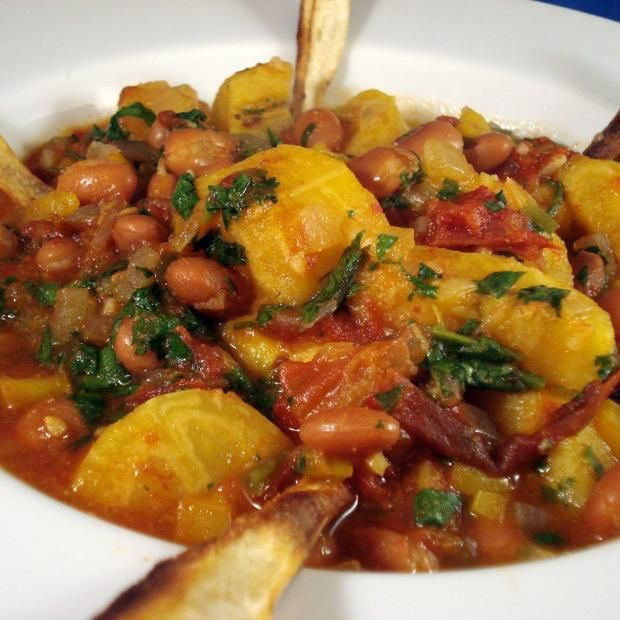 Plantain And Pinto Stew With Parsnip Chips