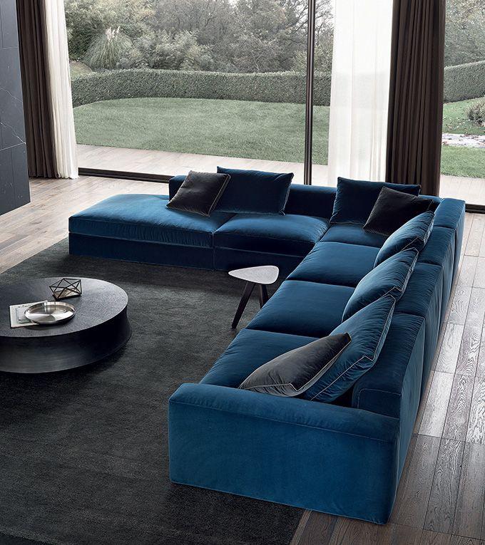 Dune sofa covered in 58 danubio Persia removable velvet, cushions in 58 danubio and 1404 carbone Persia, 50 Sahara gros grain stitchings. Dune pouf covered in 04 lava Merida removable fabric. Soori coffee table in antique bronze finishing. Ipsilon coffee table in spessart oak.