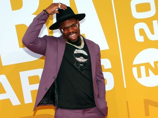 Von Miller poses for photos on the red carpet before