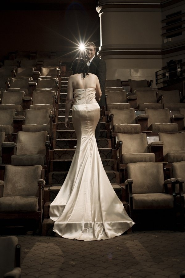 cinema! What an idea! have your wedding at an old cinema! No need to rent seats, everyone can see & you could have nature scenes or old pics of the couple. Then the lobby would be ready for reception afterwards. OOooo