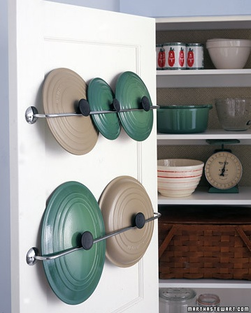 Easy way to store pot lids #storage #kitchens #potlids www.nicheredesign.com/blog/   Wish I had a pantry like this.  I think this is a close to wall towel rack on the back side of the door.  Just make sure screws are not too long and come out the other side, and that screws are in solid wood, not thin laminated board.