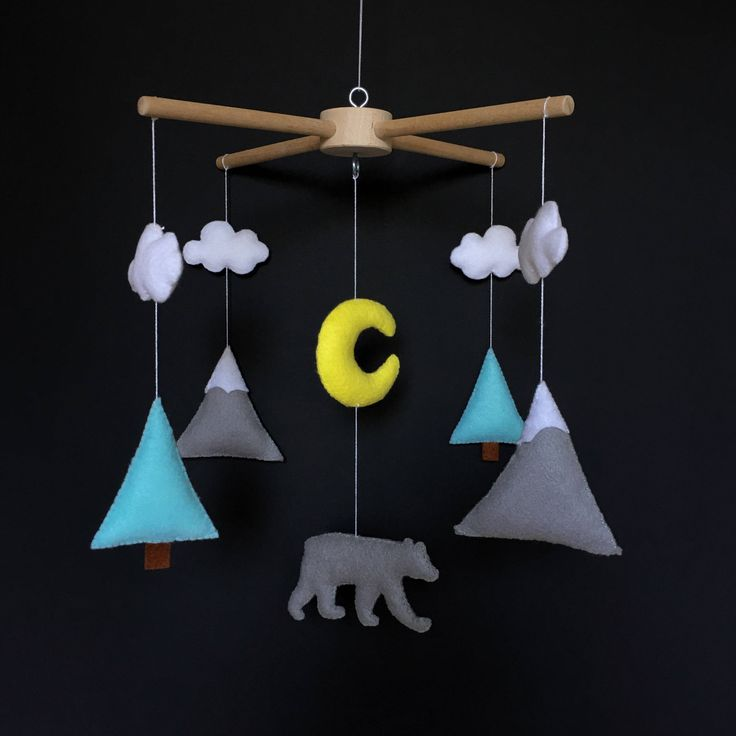 A personal favorite from my Etsy shop https://www.etsy.com/listing/545839707/mountain-mobile-baby-boy-mobile-mint