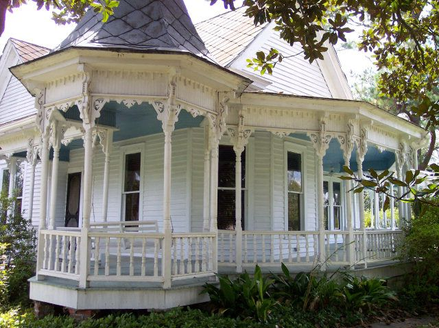 Queen Anne style 1904.  (This is what I think I want. Single Story. We could leave out the fancy trim, except for the FRONT of the house, and I want the turret to be part of the HOUSE itself, and the turret will have to be a half a story above the rest of the house, with a nice window seat.
