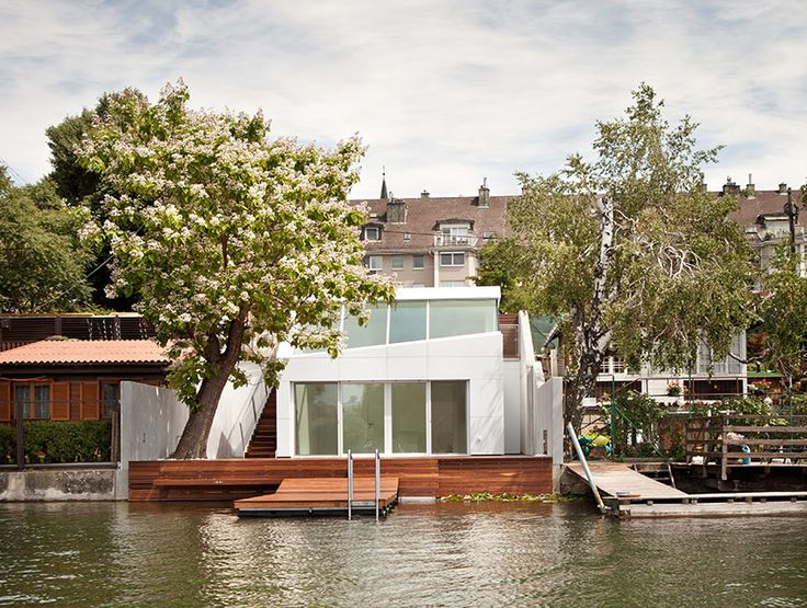 bathing hut by share architects is an oasis on the danube, vienna, austria