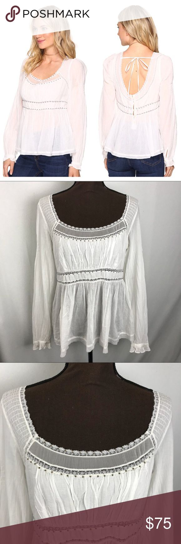 [Free People] Ivory Strangers in Love Peasant Top • NWT • Small Burn Marks on Cuff • Ivory Color • Bronze Beaded Embellishments  • Open Tie Back • 1 Button Cuff  • 5 Button Down Back  • Lace Detail On Middle & Collar • Style Name: Strangers In Love • Length: 25ins • Bust: 19ins • Sleeve Length: 26ins • 100% Cotton Free People Tops Blouses