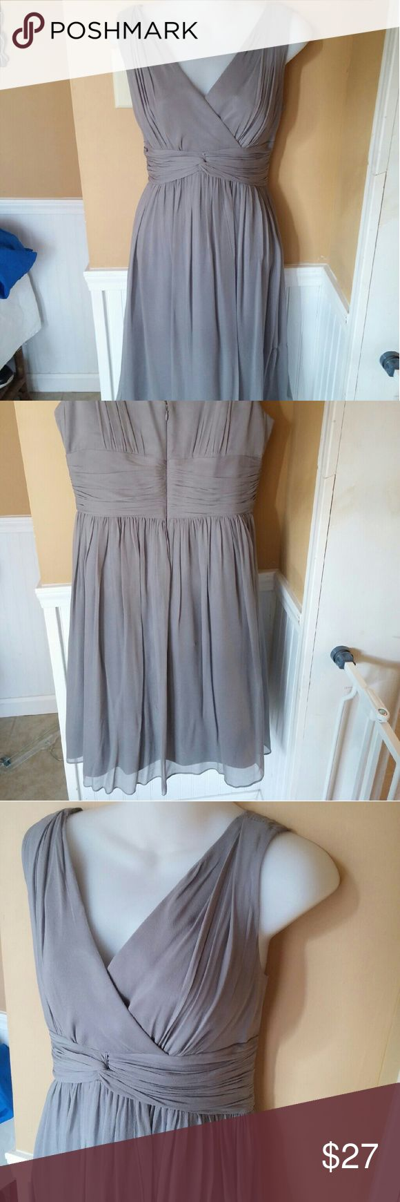 Donna Morgan Dress Gray Tea Length 12 Wedding. Lovely Donna Morgan Wedding or Bridesmaid silk dress!  Silk chiffonexterior and acetate lining.  Tea Length.  Excellent condition non smoking household.  Tiny scuff on surface of silk on skirt not very noticeable.  Bust 39 Waist 35 Length shoulder to hem 40 Donna Morgan Dresses Wedding