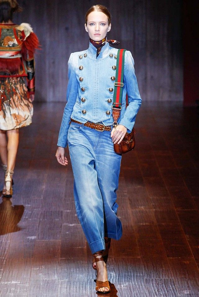 Gucci does a '70s-inspired look with wide-leg jeans, a printed neckerchief, and a braided belt.