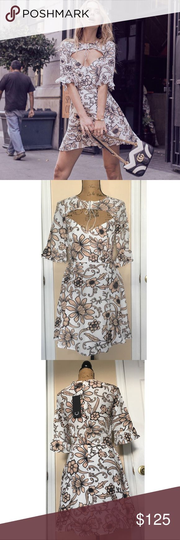 """✨🎀BF SALE🎀 For Love & Lemons Ayla Laced-Up Dress For Love & Lemons Ayla Laced-Up Floral Print Mini Dress features an open neckline with lace-up details, elbow length sleeves with ruffle detail, flared flowing skirt and hidden back zipper. Lined. -Length is about 32"""". Measured size Small.  -Fabric: Rayon/Viscose/Polyester/Spandex Care: Dry clean For Love And Lemons Dresses"""