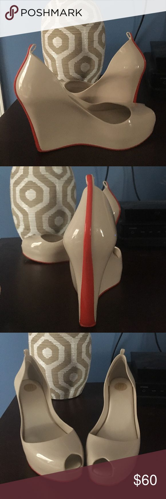 Melissa Cream Wedge Melissa cream wedge with red stripe! Bought on Poshmark(Without ankle strap!) but were too small for me! Nothing wrong with them at all except the missing ankle strap! READY TO SHIP! Melissa Shoes Wedges