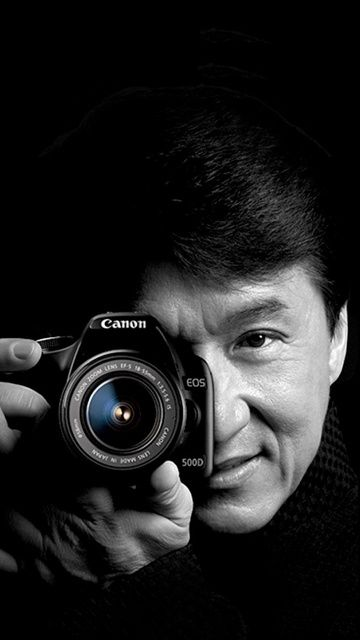 Jackie Chan WITH a Canon camera, no less...  I think I just lost my senses! *sigh*