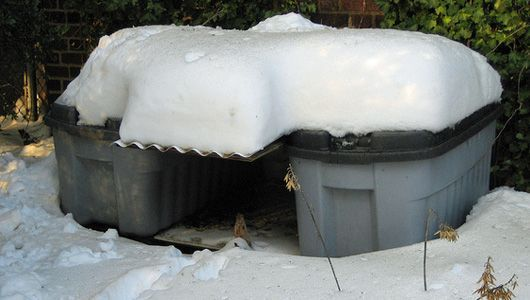 how to build a feral cat shelter. The Humane Society suggests placing two shelters with their doorways facing each other and securing a board between them to create a canopy.  (Each container is an insulated container-within-a-container.)