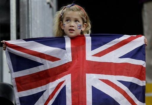 A fan holds a British flag during a preliminary men's basketball game between Lithuania and the United States at the 2012 Summer Olympics, Saturday, Aug. 4, 2012, in London. (AP Photo/Eric Gay)