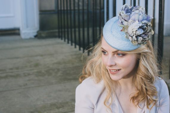 Elegant straw percher hat with two silk flowers for wedding guest or races.