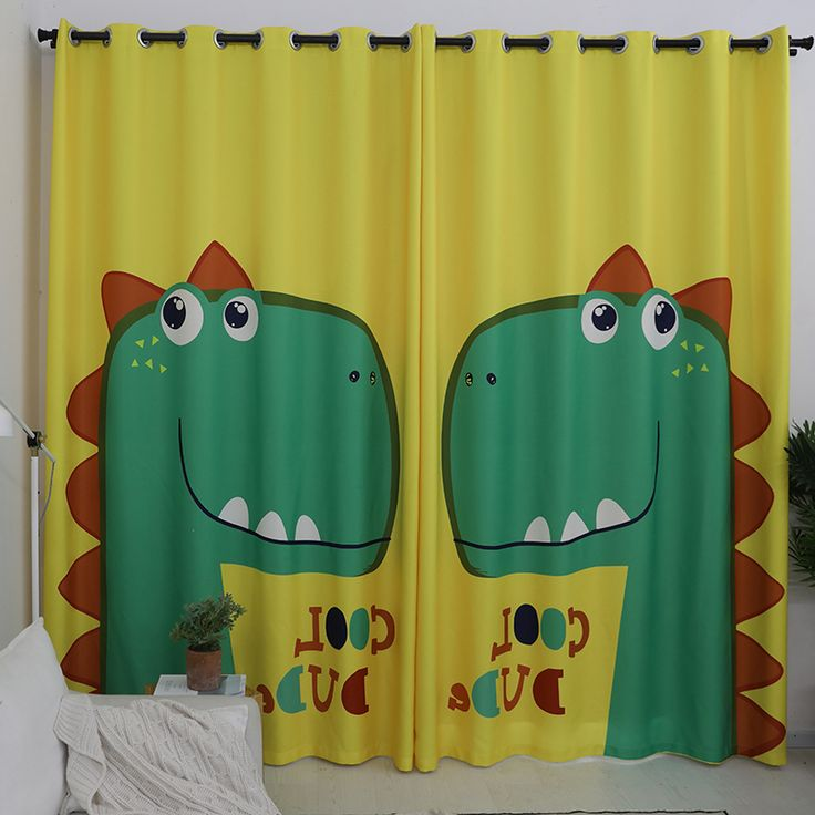 The yellow cute kids curtain decorated with green cartoon dinosaur patterns can create a dreamy and fun environment.