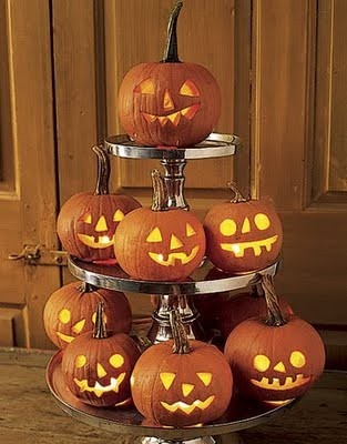 Halloween:  Little Pumpkins on multi-tiered pedestal.  (***might   want to add candy corns into the base of each pedestal level.)