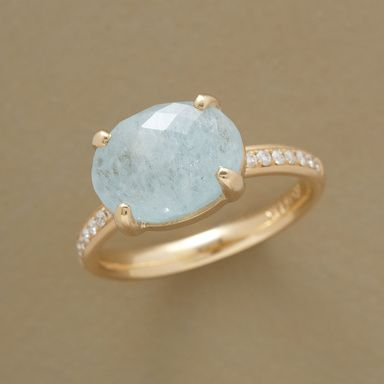 DOUBLE ENTENDRE RING -- In a gemstone double entendre, Anne Sportun flanks a faceted aquamarine with inlaid diamonds—seven sparklers on each side. Exclusively ours; handmade in Canada of 14kt matte gold with polished prongs. Whole sizes 5 to 8.