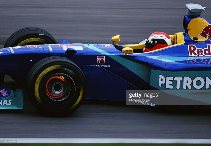 Johnny Herbert of Great Britain lights up the glowing brake discs as he drives the #15 Red Bull Sauber Petronas Sauber C17 Petronas V10 during the Austrian Grand Prix on 26th July 1998 at the A1-Ring in Spielberg, Austria.