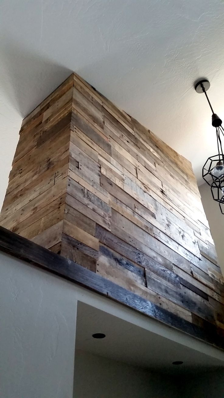 Great way to wrap a corner using our Prefab Wall panels. Pictured here in our All Natural Pallet Wood.