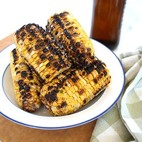 Beer Soaked Corn with Santa Fe Butter, a recipe from the ATCO Blue Flame Kitchen.