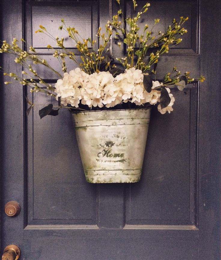 In love with our new spring Hobby Lobby door decor! (front porch plants entrance)