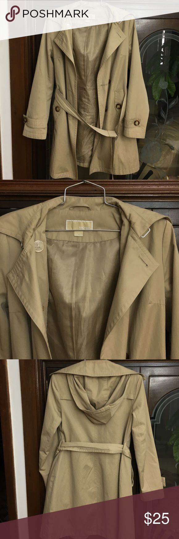 Michael by Michael Kors Trench Coat with Hood XS Pre-owned. Michael Kors beige trench coat with detachable hood and belt. Used multiple times. Fits XS and S. Some buttons and top of one pocket re-sewn (see pictures). Coffee stain on front of left side (see picture). Sold as is. MICHAEL Michael Kors Jackets & Coats Trench Coats