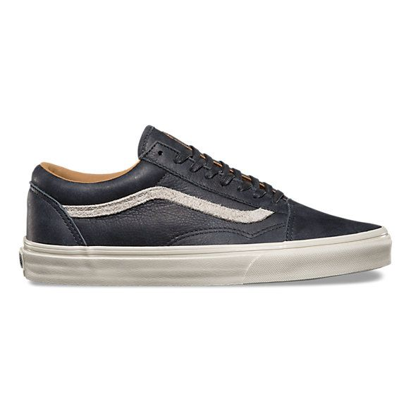 The Varsity Old Skool Reissue DX, the Vans classic skate shoe reissued with a vintage sensibility, features deluxe leather and suede uppers with suede sidestripes, UltraCush sockliners for long lasting comfort, padded collars for support and flexibility, and signature rubber waffle outsoles.