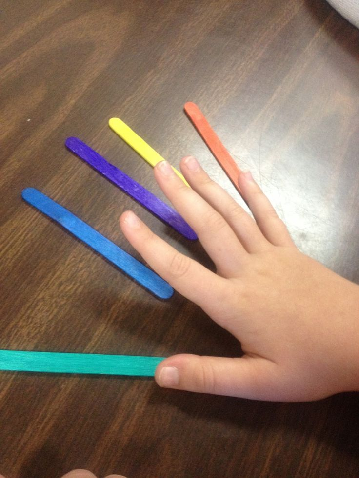 """Real-Life """"Dexteria"""" for when the i-Pad app is a little too fast: Finger isolation. I call out the color, the child touches the popsicle stick with just that finger. Hopefully it will carry over to the iPad app once speed improves :)"""