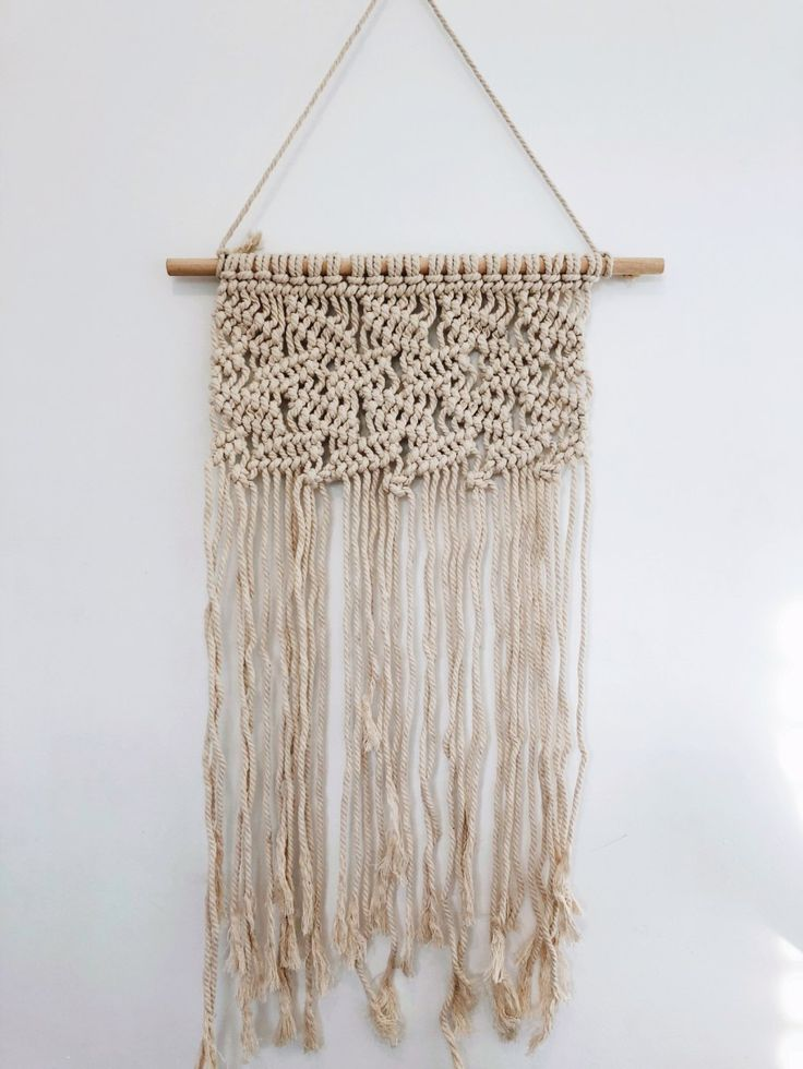 Macrame boho leaves wall hanging. Includes extra rope for hanging.