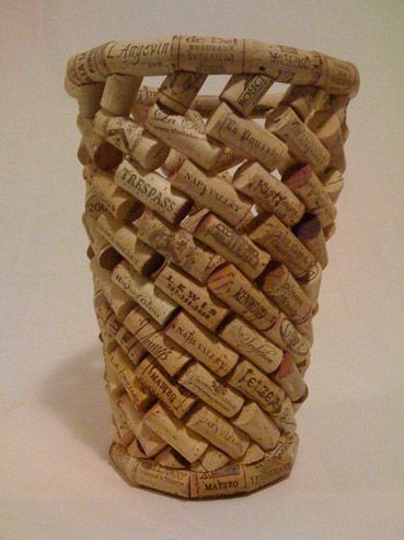 Ha! Instead of throwing the corks into a basket - make the basket out of the corks!