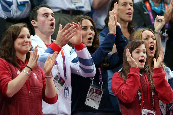 Roar of the crowd - Kate Middleton enjoys the atmosphere with gymnasts, from left, Jennifer Pinches, Kristian Thomas and Rebecca Tunney during the artistic gymnastics men's pommel Horse final on Day 9.