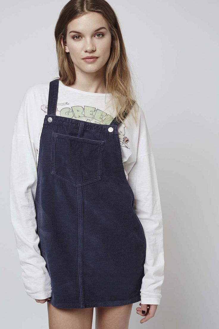 Opt for an alternative to denim with this MOTO cord pinafore dress. In a clean, textured finish, there's a distinctive '70s edge to this throw-on style. Comes with practical patch pockets and button shoulder fastenings. #Topshop
