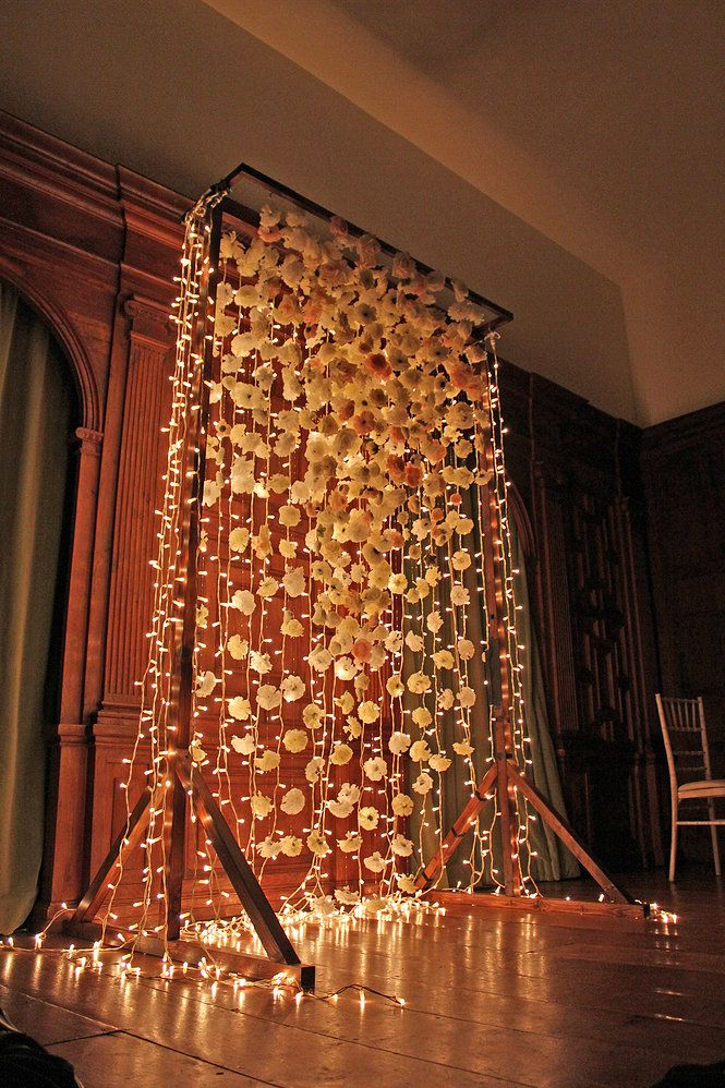 Bespoke flower altar backdrop made by Cotton and Beau.