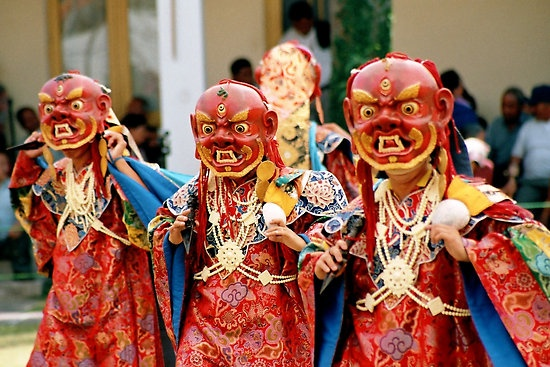 Tibetan masked Buddhist monks during the Tsechu Chaam Festival, Tibet. photo by Tim Buckley