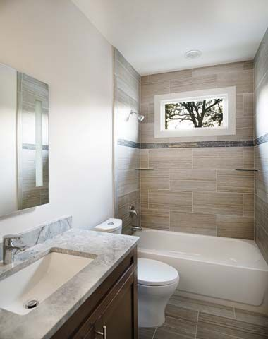this modern style bathroom features porcelain tile surround with accent strip espresso wood cabinet with