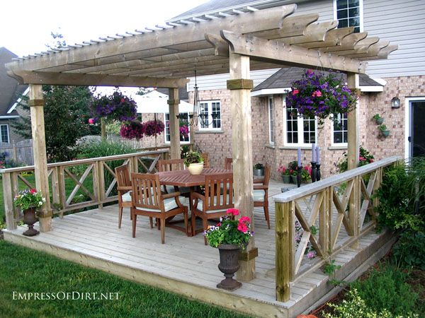 20+ Ways to create vertical interest in the garden with arbors, trellis, obelisks, and more. Outdoor dining area.