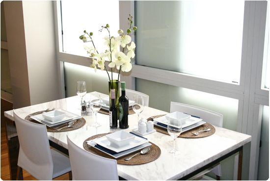 Delightful Luxury Dining Area Description :: Marble Top Dining Table, Oval Woven  Placemats, Square White Plates, White Porcelain Salt And Pepper Shakers And  Wu2026