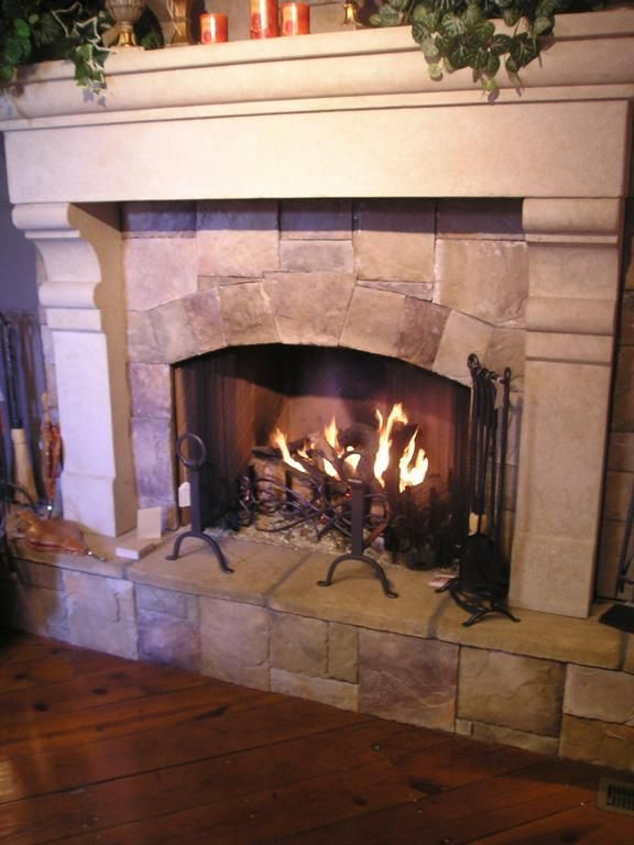 stone inside wood fireplace. actually I think the molding around the edge is carved stone, but looks like wood and shows how wood could look great