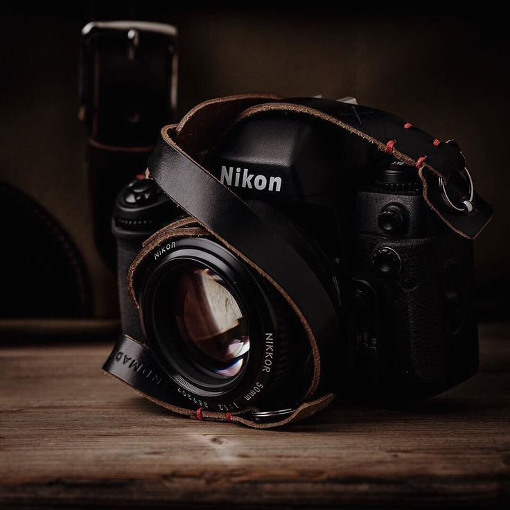 The indestructible and now legendary Nikon F100 with our Westminster camera neck strap and Marlborough bag peeking out from behind.