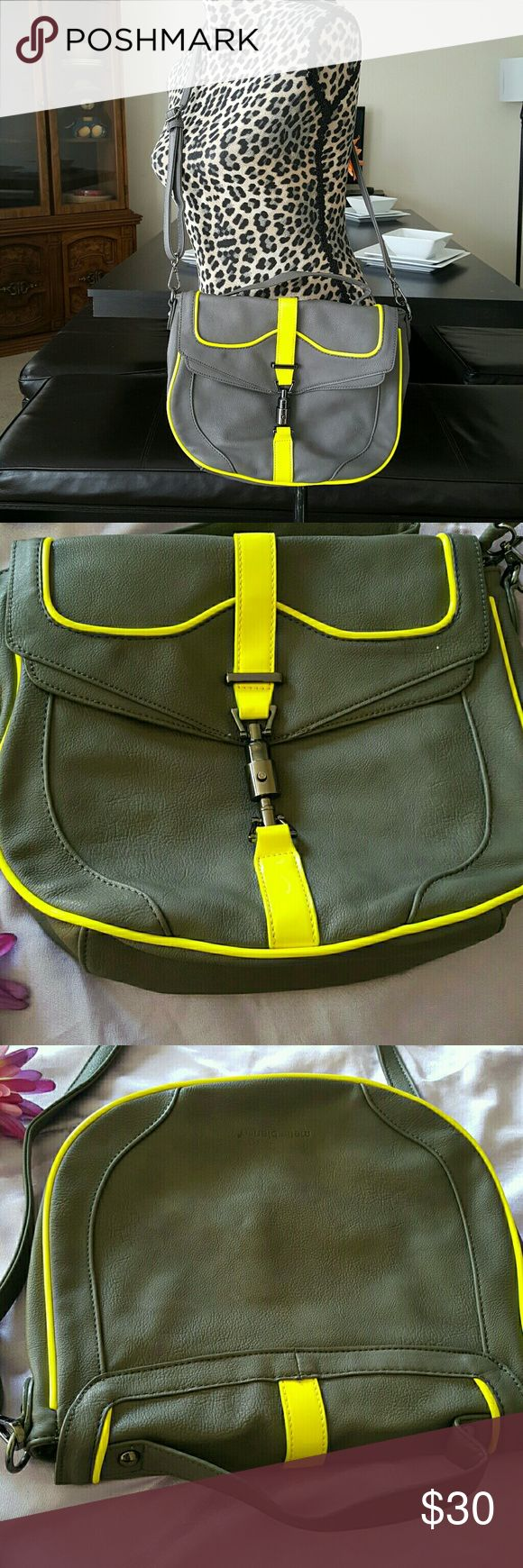 "Melie Bianco Crossbody Bag Good Condition shows minor wear see photos  Color Lime Green and Gray Neon Trim Patent neon trim fires up a top-handle messenger bag furnished with an optional strap. Push-lock flap with zip closure. Interior zip, wall and cell phone pockets. Satin lining. Polyurethane. By Melie Bianco; imported. Dimensions: 11W x 10H x 2 1/2 D Strap drop: 3"". Crossbody strap drop: 11 1/2"" - 23 1/2"". Melie Bianco Bags Crossbody Bags"